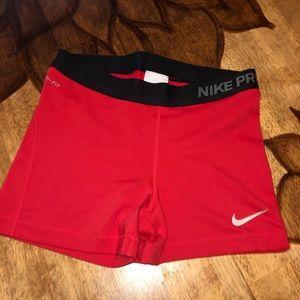 Red Nike Pro shorts